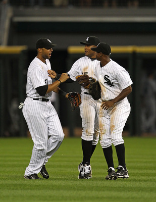 CHICAGO - JULY 26: (L-R) Alex Rios #51, Andruw Jones #25 and Juan Pierre #1 of the Chicago White Sox celebrate a win over the Seattle Mariners at U.S. Cellular Field on July 26, 2010 in Chicago, Illinois. The White Sox defeated the Mariners 6-1. (Photo by