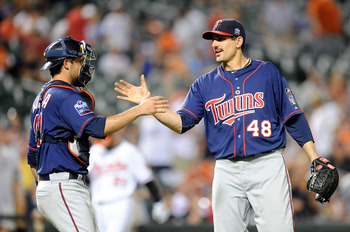 BALTIMORE - JULY 22:  Carl Pavano #48 of the Minnesota Twins celebrates with Drew Butera #41 after pitching a complete game shutout against the Baltimore Orioles at Camden Yards on July 22, 2010 in Baltimore, Maryland.  The Twins won the game 5-0. (Photo