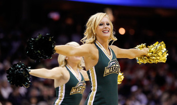 CLEVELAND, OH - MARCH 18: The George Mason Patriots cheerleaders perform during the game against the Xavier Musketeers during the second round of the 2011 NCAA men's basketball tournament at Quicken Loans Arena on March 18, 2011 in Cleveland, Ohio.  (Phot