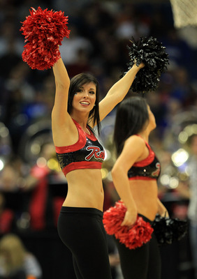 TULSA, OK - MARCH 18:  Cheerleaders for the UNLV Rebels perform during the second round game against the Illinois Fighting Illini in the 2011 NCAA men's basketball tournament at BOK Center on March 18, 2011 in Tulsa, Oklahoma.  (Photo by Ronald Martinez/G