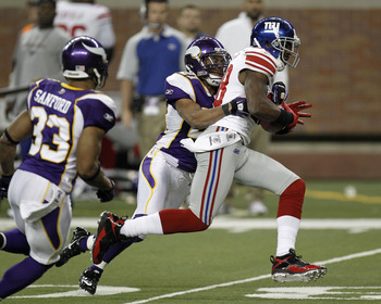 DETROIT, MI - DECEMBER 13:  Hakeem Nicks #88 of the New York Giants tries to out run the tackle of Asher Allen #21 of the Minnesota Vikings at Ford Field on December 13, 2010 in Detroit, Michigan.  (Photo by Gregory Shamus/Getty Images)