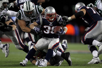 FOXBORO, MA - JANUARY 16:  Mike DeVito #70 of the New York Jets tackles Danny Woodhead #39 of the New England Patriots during their 2011 AFC divisional playoff game at Gillette Stadium on January 16, 2011 in Foxboro, Massachusetts.  (Photo by Jim Rogash/G