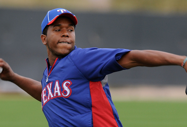 SURPRISE, AZ - FEBRUARY 18:  Neftali Feliz #30 of the Texas Rangers warms up prior to spring workouts at Surprise Stadium on February 18, 2011 in Surprise, Arizona.  (Photo by Norm Hall/Getty Images)