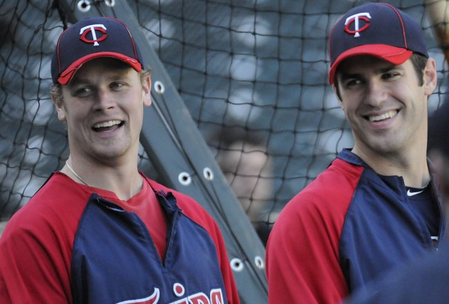MINNEAPOLIS, MN - MAY 27: Justin Morneau #33 and Joe Mauer #7 of the Minnesota Twins during batting practice prior to the game against the New York Yankees on May 27, 2010 at Target Field in Minneapolis, Minnesota. The Twins defeated the Yankees 8-2. (Pho