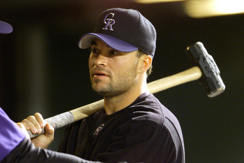 07 Sep 2001: Pitcher Mike Hampton of the Colorado Rockies picks up a sledgehammer during 3 hour 45 minute game against the San Francisco Giants at Coors Field in Denver, Colorado.  The Rockies won  3-2. DIGITAL IMAGE. Mandatory Credit : Brian Bahr/Allspor