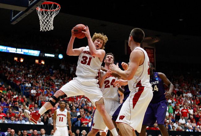 TUCSON, AZ - MARCH 19:  Mike Bruesewitz #31 of the Wisconsin Badgers pulls down a rebound against the Kansas State Wildcats during the third round of the 2011 NCAA men's basketball tournament at McKale Center on March 19, 2011 in Tucson, Arizona.  (Photo