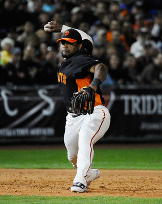 SCOTTSDALE, AZ - MARCH 07:  Pablo Sandoval #48 of the San Francisco Giants throws to first base during  an exhibition baseball game against the Texas Rangers in the first meeting between the two teams since the World Series at Scottsdale Stadium on March