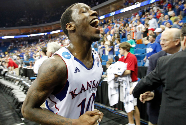TULSA, OK - MARCH 20:  Tyshawn Taylor #10 of the Kansas Jayhawks jogs off the court after defeating the Illinois Fighting Illini 59-73 in the third round of the 2011 NCAA men's basketball tournament at BOK Center on March 20, 2011 in Tulsa, Oklahoma.  (Ph