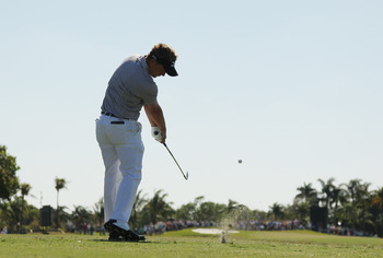 DORAL, FL - MARCH 13:  Luke Donald of England hits his tee shot on the fourth hole during the final round of the 2011 WGC- Cadillac Championship at the TPC Blue Monster at the Doral Golf Resort and Spa on March 13, 2011 in Doral, Florida.  (Photo by Mike