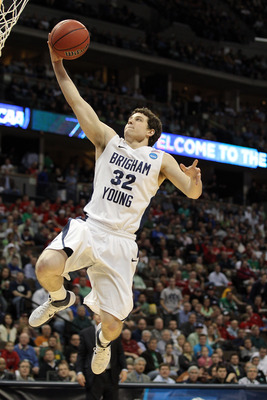 DENVER, CO - MARCH 17:  Jimmer Fredette #32 of the Brigham Young Cougars goes to the hoop for a layup against the Wofford Terriers during the second round of the 2011 NCAA men's basketball tournament at Pepsi Center on March 17, 2011 in Denver, Colorado.