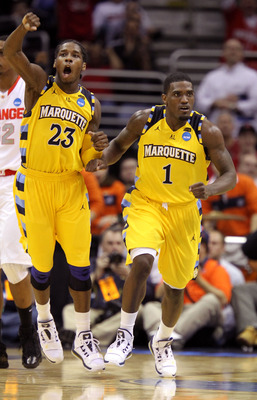 CLEVELAND, OH - MARCH 20: Dwight Buycks #23 and Darius Johnson-Odom #1 of the Marquette Golden Eagles celebrate late in the game against the Syracuse Orange during the third of the 2011 NCAA men's basketball tournament at Quicken Loans Arena on March 20,