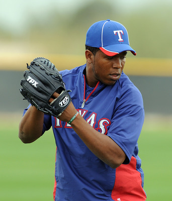 SURPRISE, AZ - FEBRUARY 18:  Neftali Feliz #30 of the Texas Rangers gets ready to deliver a pitch at Surprise Stadium on February 18, 2011 in Surprise, Arizona.  (Photo by Norm Hall/Getty Images)