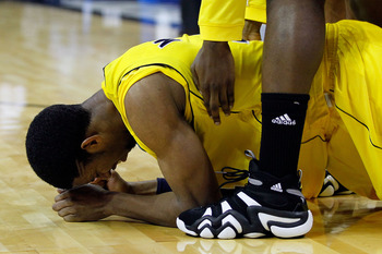 CHARLOTTE, NC - MARCH 20:  Darius Morris #4 of the Michigan Wolverines reacts after missing the tying shot as the Wolverines lose to the Duke Blue Devils 73-71 during the third round of the 2011 NCAA men's basketball tournament at Time Warner Cable Arena