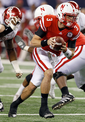 ARLINGTON, TX - DECEMBER 04:  Quarterback Taylor Martinez #3 of the Nebraska Cornhuskers looks for an open receiver against the Oklahoma Sooners at Cowboys Stadium on December 4, 2010 in Arlington, Texas. The Sooners beat the Cornhuskers 23-20. (Photo by
