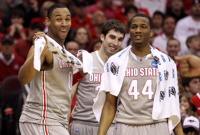 CLEVELAND, OH - MARCH 20: Jared Sullinger #0, Jon Diebler #33 and William Buford #44 of the Ohio State Buckeyes look on from the bench during the second half against the George Mason Patriots during the third of the 2011 NCAA men's basketball tournament a