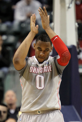 INDIANAPOLIS, IN - MARCH 13:  Jared Sullinger #0 of the Ohio State Buckeyes celebrates a play against the Penn State Nittany Lions during the championship game of the 2011 Big Ten Men's Basketball Tournament at Conseco Fieldhouse on March 13, 2011 in Indi