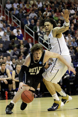 WASHINGTON - MARCH 19:  Matt Howard #54 of the Butler Bulldogs drives past Gary McGhee #52 of the Pittsburgh Panthers during the third round of the 2011 NCAA men's basketball tournament at Verizon Center on March 19, 2011 in Washington, DC.  (Photo by Rob