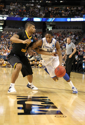 TAMPA, FL - MARCH 19:  Brandon Knight #12 of the Kentucky Wildcats drives against Casey Mitchell #3 of the West Virginia Mountaineers during the third round of the 2011 NCAA men's basketball tournament at St. Pete Times Forum on March 19, 2011 in Tampa, F