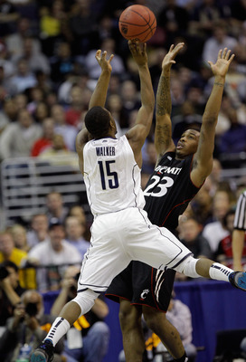WASHINGTON - MARCH 19: Kemba Walker #15 of Connecticut takes a shot over Sean Kilpatrick #23 of Cincinnati during the third round of the 2011 NCAA men's basketball tournament at Verizon Center on March 19, 2011 in Washington, DC.  (Photo by Rob Carr/Getty