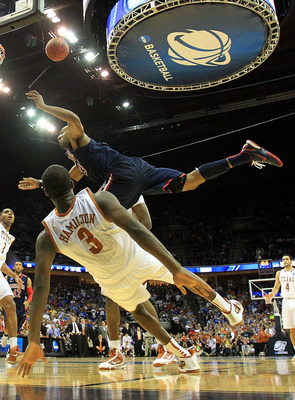 TULSA, OK - MARCH 20:  Derrick Williams #23 of the Arizona Wildcats is fouled by Jordan Hamilton #3 of the Texas Longhorns on the game tying shot during the third round of the 2011 NCAA men's basketball tournament at BOK Center on March 20, 2011 in Tulsa,