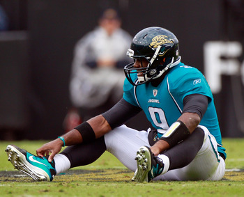 JACKSONVILLE, FL - DECEMBER 12:  Quarterback David Garrard #9 of the Jacksonville Jaguars sits on the ground after a sack during the game against the Oakland Raiders at EverBank Field on December 12, 2010 in Jacksonville, Florida.  (Photo by Sam Greenwood