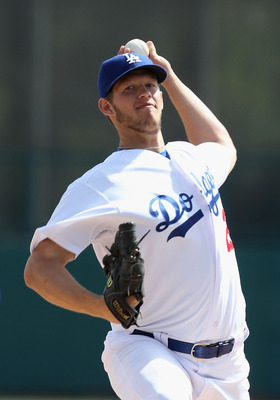 GLENDALE, AZ - MARCH 05:  Starting pitcher Clayton Kershaw #22 of the Los Angeles Dodgers pitches against the Cincinnati Reds during the spring training game at Camelback Ranch on March 5, 2011 in Glendale, Arizona.  (Photo by Christian Petersen/Getty Ima