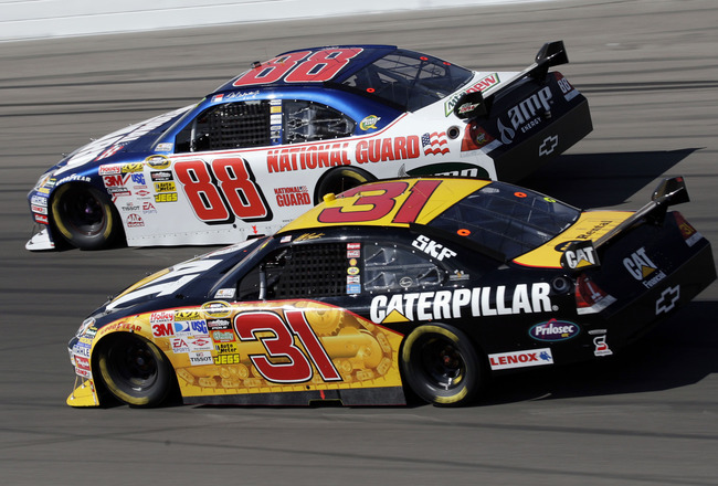 LAS VEGAS - MARCH 01: Dale Earnhardt Jr., driver of the #88 National Guard/AMP Energy Chevrolet, races against Jeff Burton, driver of the #31 Caterpillar Chevrolet, during the NASCAR Sprint Cup Series Shelby 427 at the Las Vegas Motor Speedway on March 1,