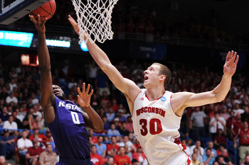 TUCSON, AZ - MARCH 19:  Jacob Pullen #0 of the Kansas State Wildcats shoots against Jon Leuer #30 of the Wisconsin Badgers in the second half during the third round of the 2011 NCAA men's basketball tournament at McKale Center on March 19, 2011 in Tucson,