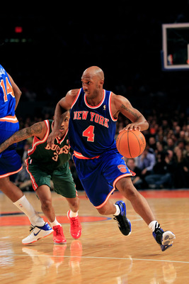 NEW YORK, NY - FEBRUARY 23:  Chauncey Billups #4 of the New York Knicks dribbles the ball past  Corey Maggette of the Milwaukee Bucks at Madison Square Garden on February 23, 2011 in New York City. NOTE TO USER: User expressly acknowledges and agrees that