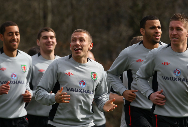 CARDIFF, WALES - MARCH 22:  Wales striker Craig Bellamy (c) shares a joke with team mates during Wales training at the Vale ahead of their UEFA EURO 2012 qualifier against England, on March 22, 2011 in Cardiff, Wales.  (Photo by Stu Forster/Getty Images)