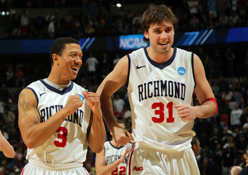 DENVER, CO - MARCH 19:  Darien Brothers #3 and Conor Smith #31 of the Richmond Spiders celebrate after defeating the Morehead State Eagles during the third round of the 2011 NCAA men's basketball tournament at Pepsi Center on March 19, 2011 in Denver, Col