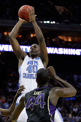 CHARLOTTE, NC - MARCH 20:  Harrison Barnes #40 of the North Carolina Tar Heels shoots over Darnell Gant #44 of the Washington Huskies during the third round of the 2011 NCAA men's basketball tournament at Time Warner Cable Arena on March 20, 2011 in Charl