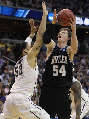 WASHINGTON - MARCH 19:  Matt Howard #54 of the Butler Bulldogs puts up a shot against Gary McGhee #52 of the Pittsburgh Panthers during the third round of the 2011 NCAA men's basketball tournament at Verizon Center on March 19, 2011 in Washington, DC.  (P