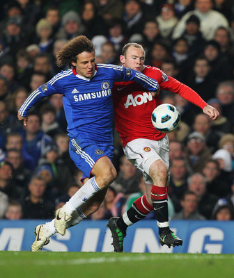 Luiz out-muscling Wayne rooney