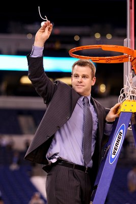 INDIANAPOLIS - APRIL 05:  Associate Head Coach Steve Wojciechowski of the Duke Blue Devils celebrates after he cut down a piece of the net following their 61-59 win against the Butler Bulldogs during the 2010 NCAA Division I Men's Basketball National Cham