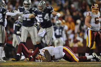 LANDOVER, MD - DECEMBER 27:  Bobby Carpenter #54 of the Dallas Cowboys defends against the Washington Redskins at FedExField on December 27, 2009 in Landover, Maryland. The Cowboys defeated the Redskins 17-0. (Photo by Larry French/Getty Images)