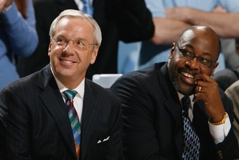 CHAPEL HILL, NC - DECEMBER 19:  Head Coach Roy Williams and Assitant Coach Steve Robinson of the North Carolina Tar Heels enjoy the action from the bench during the game against the Nicholls State Colonels during the second half at the Dean E. Smith Cente