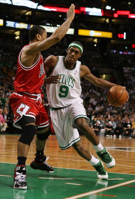 BOSTON - MAY 02:  Rajon Rondo #9 of the Boston Celtics drives around Derrick Rose #1 of the Chicago Bulls in Game Seven of the Eastern Conference Quarterfinals during the 2009 NBA Playoffs at TD Banknorth Garden on May 2, 2009 in Boston, Massachusetts. NO