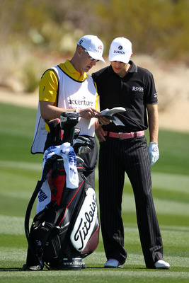 MARANA, AZ - FEBRUARY 25:  (L-R) Caddie Joel Stock and Ben Crane talk on the second hole fairway during the third round of the Accenture Match Play Championship at the Ritz-Carlton Golf Club on February 25, 2011 in Marana, Arizona.  (Photo by Andy Lyons/G