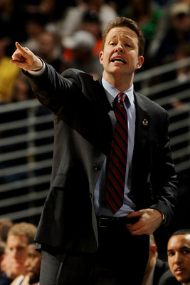 DENVER, CO - MARCH 17:  Head coach Chris Mooney of the Richmond Spiders gestures from the bench during the second round of the 2011 NCAA men's basketball tournament at Pepsi Center on March 17, 2011 in Denver, Colorado.  (Photo by Doug Pensinger/Getty Ima