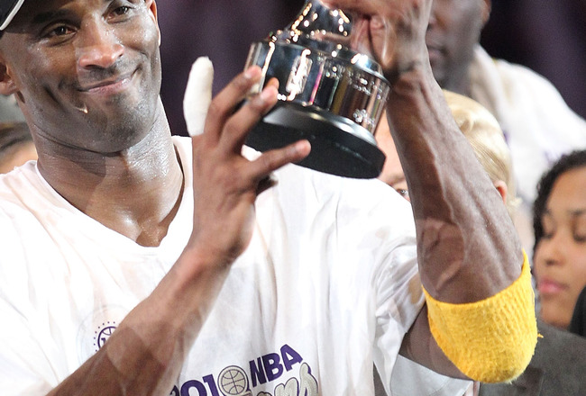 LOS ANGELES, CA - JUNE 17:  Kobe Bryant #24 of the Los Angeles Lakers holds up the Bill Russell Finals MVP trophy after the Lakers defeated the Boston Celtics 83-79 in Game Seven of the 2010 NBA Finals at Staples Center on June 17, 2010 in Los Angeles, Ca
