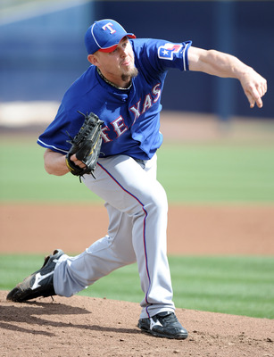 PEORIA, AZ - MARCH 01:  Matt Harrison #54 of the Texas Rangers pitches against the Seattle Mariners in the first inning during spring training at Peoria Stadium on March 1, 2011 in Peoria, Arizona.  (Photo by Harry How/Getty Images)