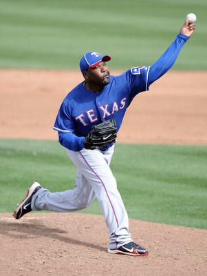 PEORIA, AZ - MARCH 01:  Arthur Rhodes #53 of the Texas Rangers pitches against the Seattle Mariners during spring training at Peoria Stadium on March 1, 2011 in Peoria, Arizona.  (Photo by Harry How/Getty Images)