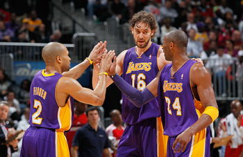 ATLANTA, GA - MARCH 08:  Derek Fisher #2, Pau Gasol #16 and Kobe Bryant #24 of the Los Angeles Lakers react after a timeout during the game against the Atlanta Hawks at Philips Arena on March 8, 2011 in Atlanta, Georgia.  NOTE TO USER: User expressly ackn