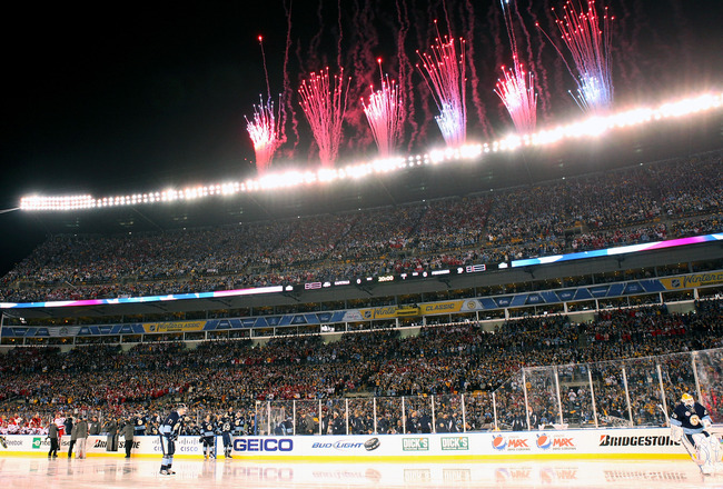 PITTSBURGH, PA - JANUARY 01:  Fireworks go off before the Pittsburgh Penguins take on the Washington Capitals during the 2011 NHL Bridgestone Winter Classic at Heinz Field on January 1, 2011 in Pittsburgh, Pennsylvania. Washington won 3-1.  (Photo by Jami