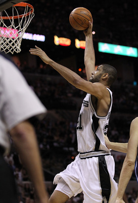 SAN ANTONIO - APRIL 23:  Forward Tim Duncan #21 of the San Antonio Spurs makes a slam dunk against the Dallas Mavericks in Game Three of the Western Conference Quarterfinals during the 2010 NBA Playoffs at AT&T Center on April 23, 2010 in San Antonio, Tex