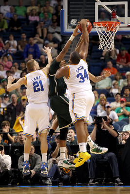 TAMPA, FL - MARCH 17: Joshua Smith #34 of the UCLA Bruins blocks a shot attempt by Adreian Payne #5 of the Michigan State Spartans  during the second round of the 2011 NCAA men's basketball tournament at St. Pete Times Forum on March 17, 2011 in Tampa, Fl