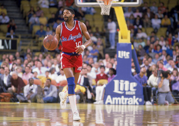LOS ANGELES - JANUARY 1:  Norm Nixon #10 of the Los Angeles Clippers dribbles the ball during the NBA game against the Los Angeles Lakers at the Great Western Forum, in Los Angeles, California on January 1, 1989.  NOTE TO USER: User expressly acknowledges