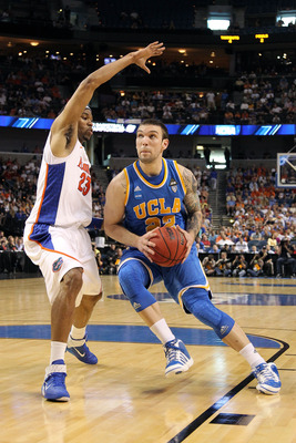 TAMPA, FL - MARCH 19:  Reeves Nelson #22 of the UCLA Bruins drives against Alex Tyus #23 of the Florida Gators during the third round of the 2011 NCAA men's basketball tournament at St. Pete Times Forum on March 19, 2011 in Tampa, Florida.  (Photo by Mike