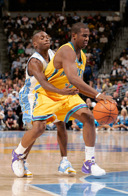 DENVER - NOVEMBER 30:  Chris Paul #3 of the New Orleans/Oklahoma City Hornets drives past Earl Boykins #11 of the Denver Nuggets during the game at Pepsi Center on November 30, 2005 in Denver, Colorado.  The Hornets won 102-95.   NOTE TO USER: User expres